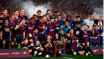 Barca clinch La Liga title after Lionel Messi winner