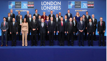 NATO leaders attempt united front after day of drama