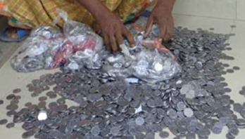 5 sacks of coins found under soil of grocery!
