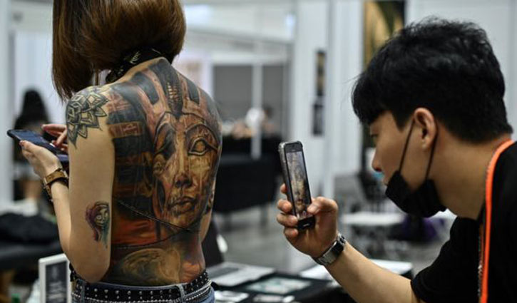 'Half naked' tattoo show goes viral in Malaysia