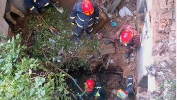 Century-old building collapses, one body recovered