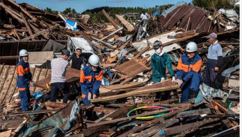 Japan deploys 110,000 rescuers after worst storm in decades