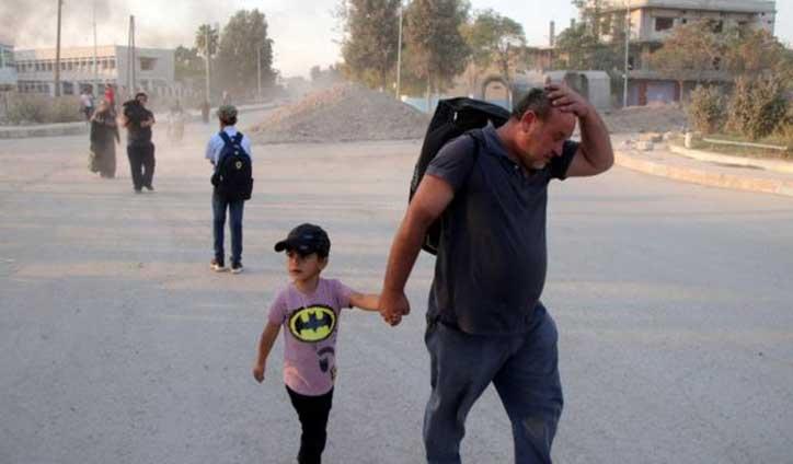 Tens of thousands flee as Turkey steps up assault