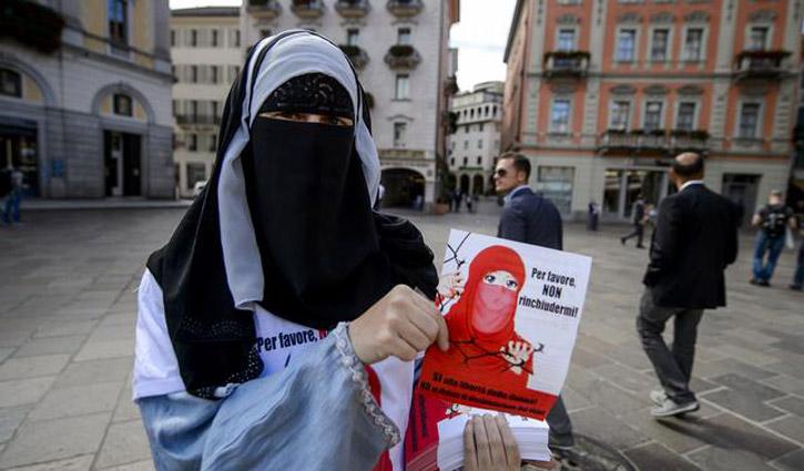 Swiss vote on `burqa ban`