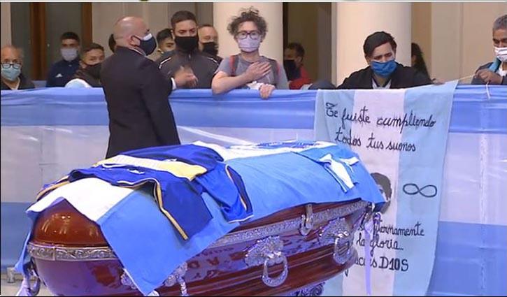 Maradona buried beside his parents