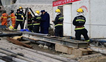 Eleven trapped miners rescued in China after 14 days