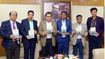 FM unveils Uday Hakim's new book 'Rohossomoy Adam Pahar' (Video)
