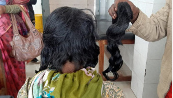 Man arrested over cutting off wife's hair