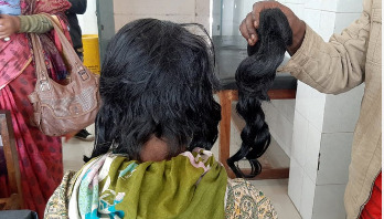Woman's hair cut off over family dispute