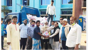 Information Minister distributes food among 500 families