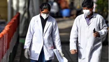Coronavirus: India doctors 'spat at and attacked'
