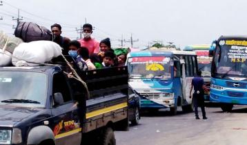 বঙ্গবন্ধু সেতু মহাসড়ক দিয়ে ট্রাক-পিকআপে ফিরছে মানুষ