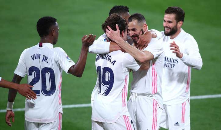 Benzema double takes Real level at the top