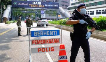 Malaysia goes into lockdown