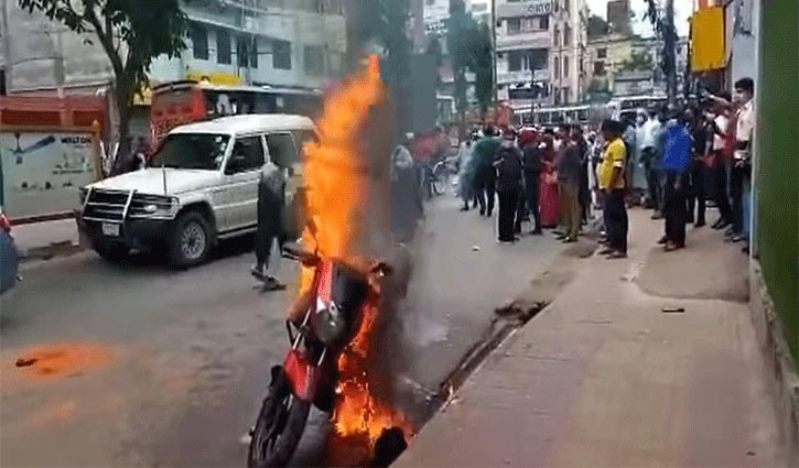 Youth sets his motorcycle on fire