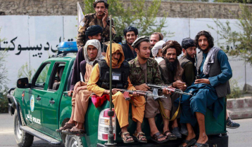 Taliban hang bodies of 4 men from cranes