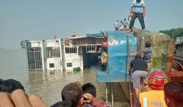Ferry with vehicles turns turtle at Paturia Ghat